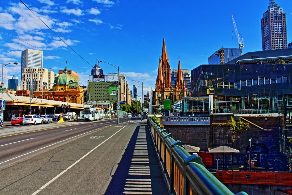 On the streets of Melbourne looking towards Federation Square and Flinders Street Station